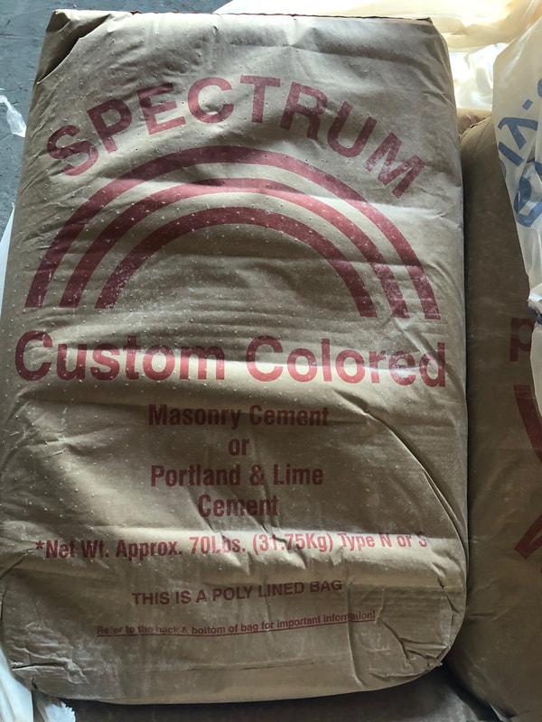 We carry spectrum cement in white, Texas tan, and caprock buff